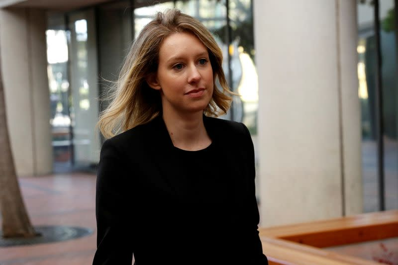 uFILE PHOTO: Former Theranos CEO Elizabeth Holmes arrives for a hearing at a federal court in San Jose