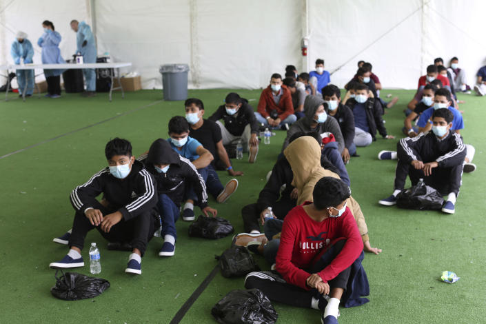 Young migrants wait to be tested for Covid-19 at the Department of Homeland Security holding facility on March 30, 2021 in Donna, Texas. (Dario Lopez-Mills - Pool/Getty Images)