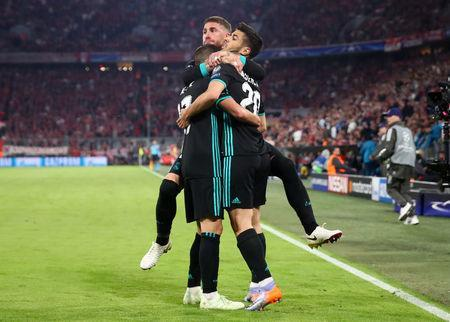 Real Madrid's Marco Asensio celebrates with Sergio Ramos and Lucas Vazquez after scoring their second goal. REUTERS/Michael Dalder