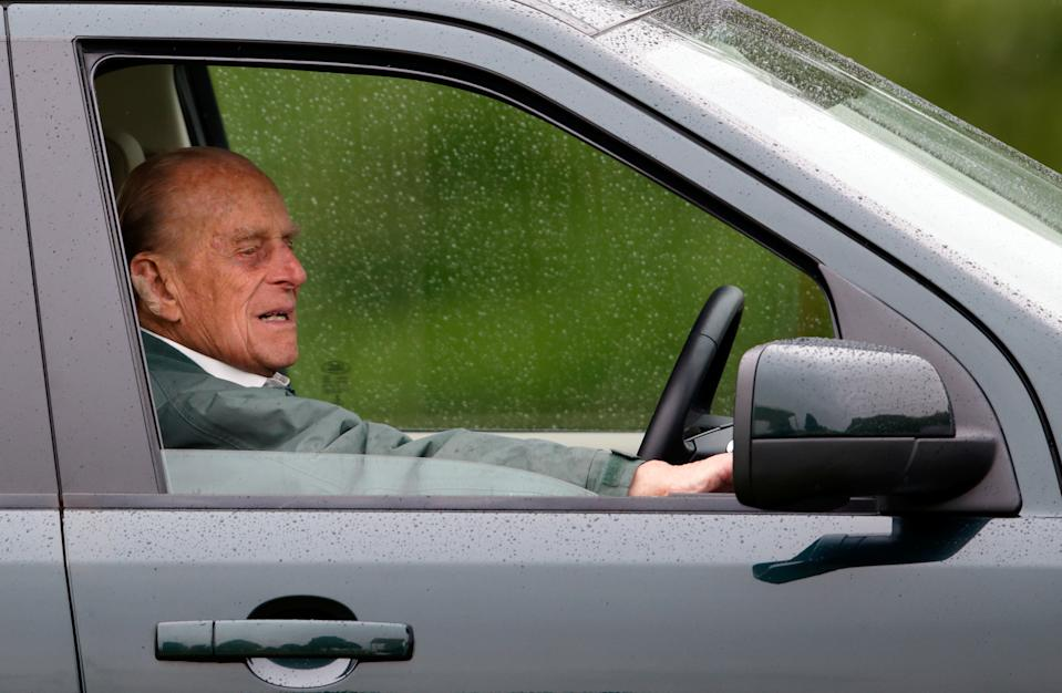 WINDSOR, UNITED KINGDOM - MAY 14: (EMBARGOED FOR PUBLICATION IN UK NEWSPAPERS UNTIL 48 HOURS AFTER CREATE DATE AND TIME) Prince Philip, Duke of Edinburgh watches the Dressage phase of the Carriage Driving competition whilst sitting in his Land Rover on day 2 of the Royal Windsor Horse Show in Home Park on May 14, 2015 in Windsor, England. (Photo by Max Mumby/Indigo/Getty Images)