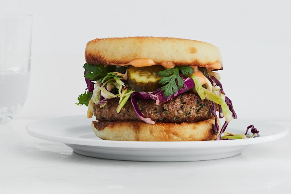 """These Southeast Asian dumpling filling–inspired pork burgers will become your new go-to favorite weeknight meal. The sweet and spicy mayo acts as both a dressing for the slaw and the sauce for the burger. <a href=""""https://www.epicurious.com/recipes/food/views/sesame-pork-burgers-with-sweet-and-spicy-slaw?mbid=synd_yahoo_rss"""" rel=""""nofollow noopener"""" target=""""_blank"""" data-ylk=""""slk:See recipe."""" class=""""link rapid-noclick-resp"""">See recipe.</a>"""
