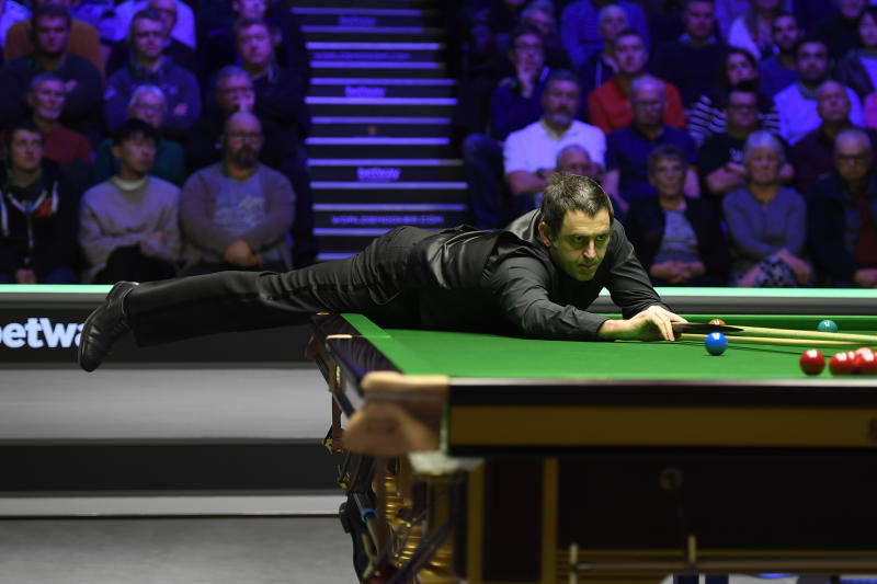 YORK, ENGLAND - DECEMBER 05: Ronnie O'Sullivan plays a shot during his match against Ding Junhui in the fourth round of the Betway UK Championship at The Barbican on December 05, 2019 in York, England. (Photo by George Wood/Getty Images)