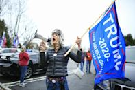 "A woman shouts slogans as Trump Supporters gather during a car rally under the slogan ""Stop the Steal"" on November 22, 2020 in Long Valley, New Jersey"