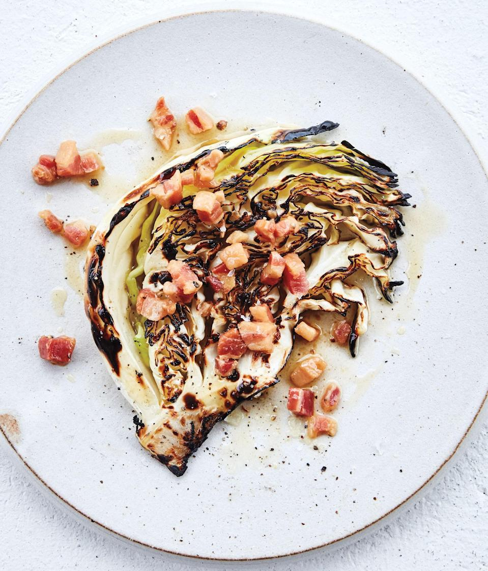 """Not that there's anything wrong with coleslaw and sauerkraut, but cabbage has so much more potential. It's phenomenal grilled. Cut into thin wedges and seared directly over the fire, it develops fantastic flavor and texture. Top it with a warm vinaigrette spiked with crisp bits of pancetta and everyone is happy. <a href=""""https://www.epicurious.com/recipes/food/views/cabbage-wedges-with-warm-pancetta-vinaigrette?mbid=synd_yahoo_rss"""" rel=""""nofollow noopener"""" target=""""_blank"""" data-ylk=""""slk:See recipe."""" class=""""link rapid-noclick-resp"""">See recipe.</a>"""