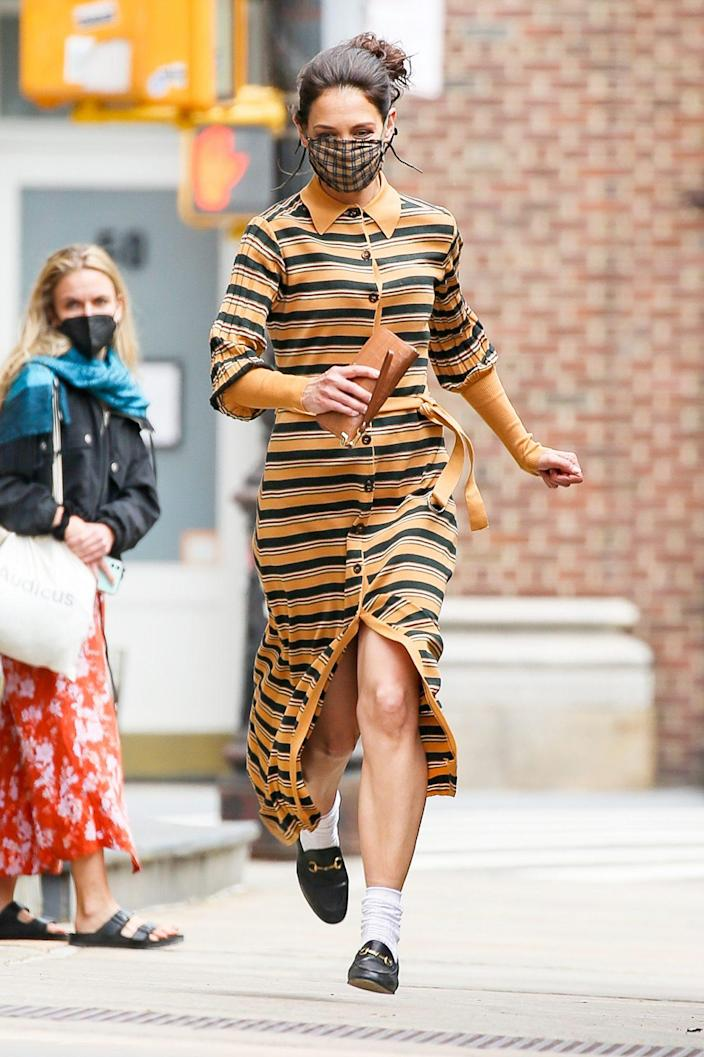 <p>Katie Holmes is spotted running into a building during a photoshoot on Monday in N.Y.C.</p>