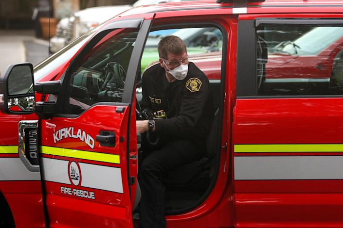 A firefighter in Kirkland, Wash., the epicenter of one of the biggest coronavirus outbreaks in the U.S. (Jason Redmond/Reuters)