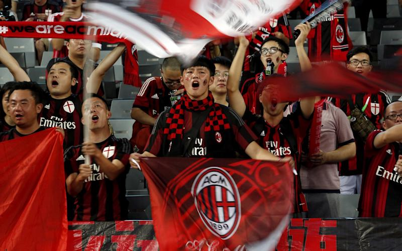 Chinese fans of AC Milan sing before their team's International Champions Cup friendly - Credit: Reuters