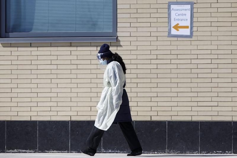 A healthcare worker outside of an assessment centre in Mississauga, Ont. Photographer: Cole Burston/Bloomberg. Image via Getty Images.