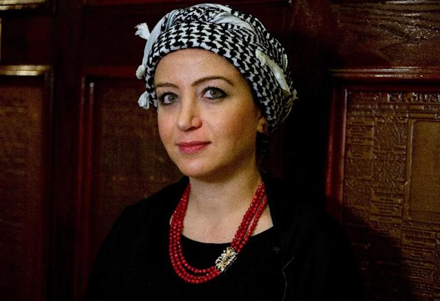 Syrian journalist Zaina Erhaim poses for a photo before receiving the Peter Mackler award at the National Press Club in Washington, DC on October 22, 2015 (AFP Photo/Andrew Caballero-Reynolds)