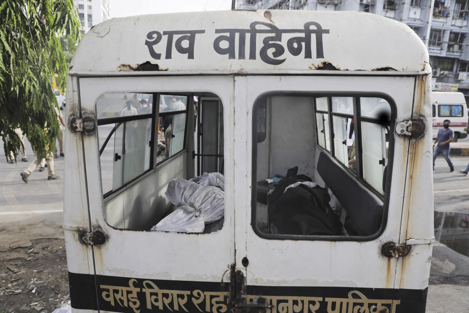 Bodies of victims of a fire lie inside an ambulance in Vijay Vallabh COVID-19 hospital at Virar, near Mumbai, India, Friday, April 23, 2021. A fire killed 13 COVID-19 patients in a hospital in western India early Friday as an extreme surge in coronavirus infections leaves the nation short of medical care and oxygen. (AP Photo)