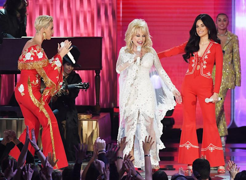 Kacey in the red jumpsuit, performing with Dolly Parton at the Grammys 2019.