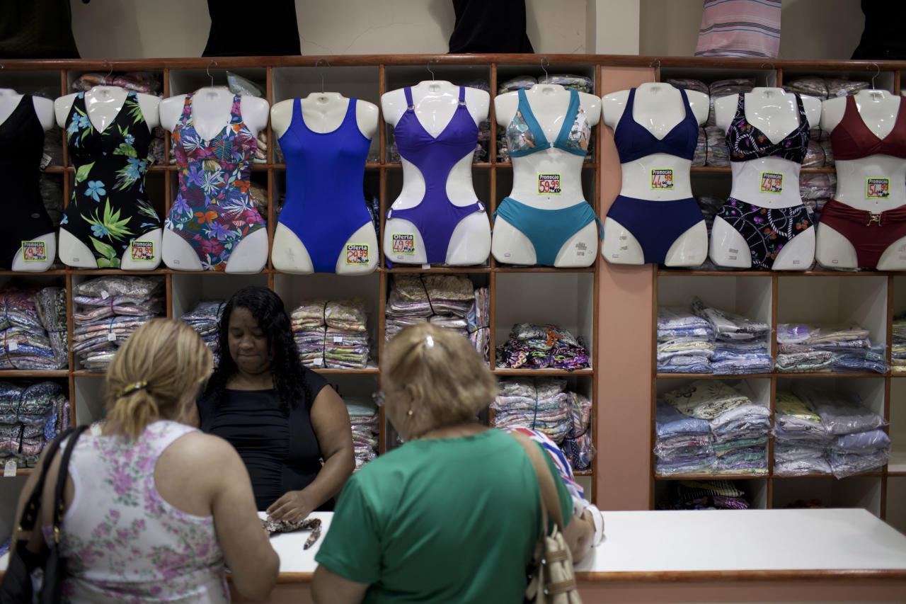 In this photo taken Jan. 27, 2012, people shop for bikinis at a store in Rio de Janeiro, Brazil. A growing number of bikini manufacturers have woken up to Brazil's thickening waistline and are reaching out to the ever-expanding ranks of heavy women with new plus-size lines. (AP Photo/Felipe Dana)