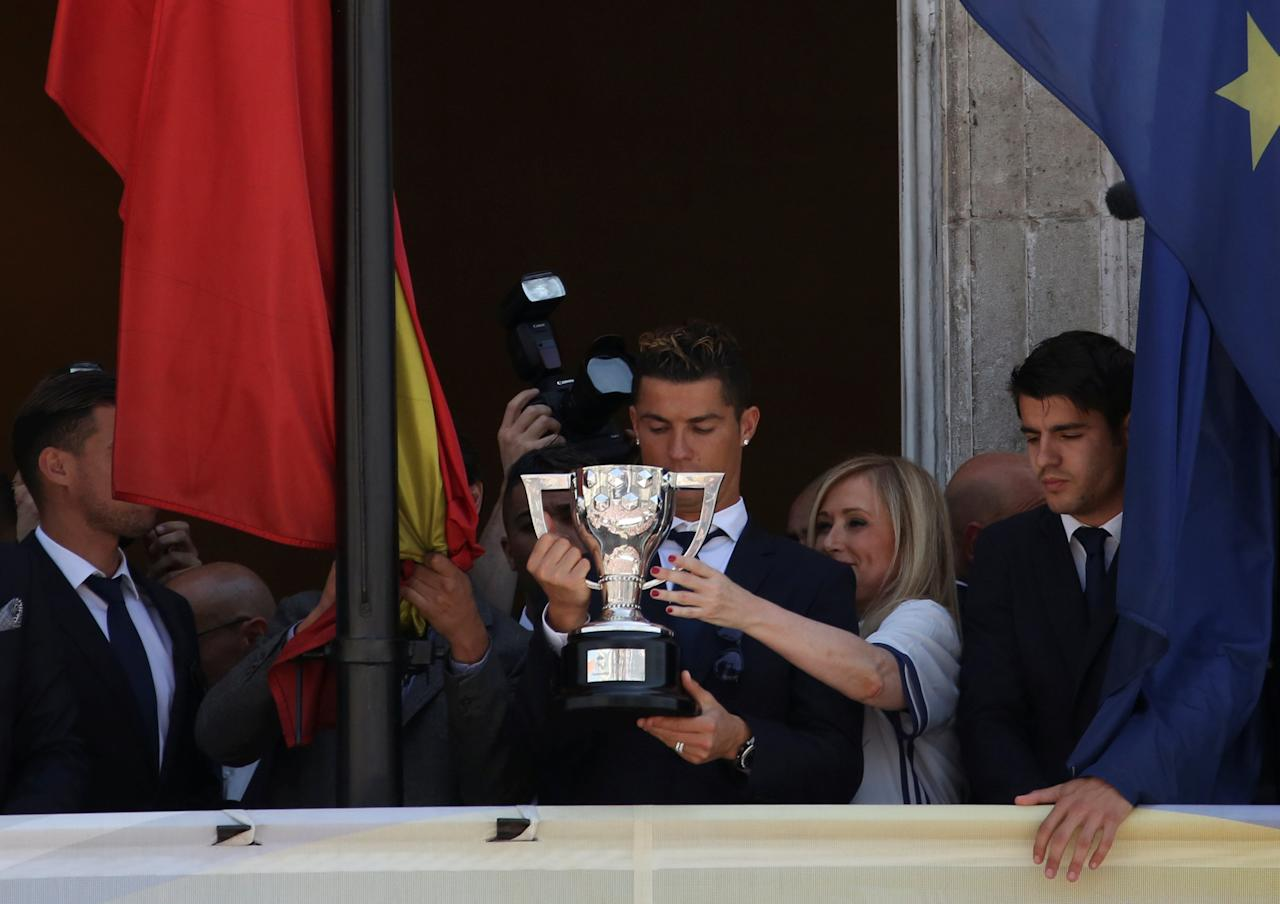 Real Madrid's Cristiano Ronaldo celebrates after winning La Liga title on a balcony at the headquarters of Madrid's regional government in Madrid, Spain, May 22, 2017. REUTERS/Susana Vera