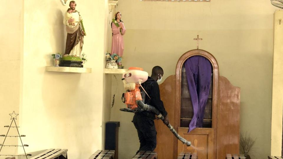 A man disinfests the parish of Saint Paul de Grand Yoff in Dakar on October 31, 2020.