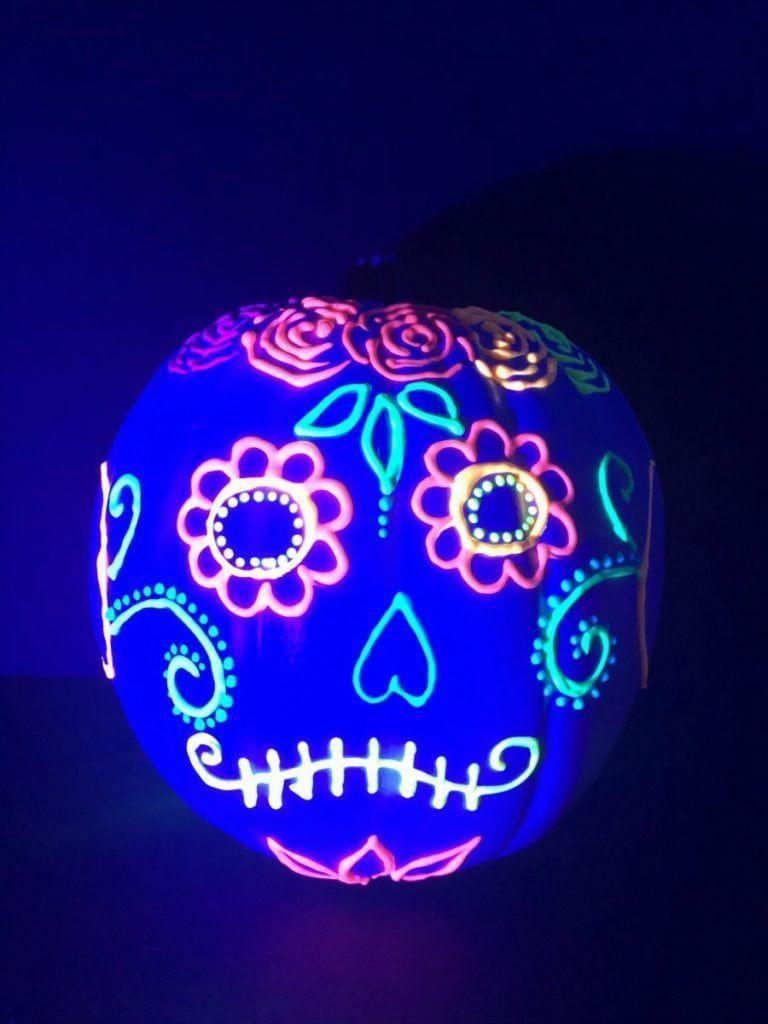"""<p>You'll light up over this creation. Get crafty and design your pumpkin however you'd like — but make sure you use glow-in-the-dark paint. This pumpkin will look awesome during the day, but will be jaw-dropping when the lights go out. <em><br></em></p><p><a class=""""link rapid-noclick-resp"""" href=""""https://www.amazon.com/Tulip-29025-Dimensional-Fabric-6-Pack/dp/B005E0CD0G/ref=as_li_ss_tl?tag=syn-yahoo-20&ascsubtag=%5Bartid%7C10055.g.23570028%5Bsrc%7Cyahoo-us"""" rel=""""nofollow noopener"""" target=""""_blank"""" data-ylk=""""slk:SHOP GLOW IN THE DARK PAINT"""">SHOP GLOW IN THE DARK PAINT </a></p><p><em><em><a href=""""https://colormadehappy.com/glow-in-the-dark-pumpkins/"""" rel=""""nofollow noopener"""" target=""""_blank"""" data-ylk=""""slk:Get the tutorial at Color Made Happy"""" class=""""link rapid-noclick-resp"""">Get the tutorial at Color Made Happy </a><a href=""""https://colormadehappy.com/glow-in-the-dark-pumpkins/"""" rel=""""nofollow noopener"""" target=""""_blank"""" data-ylk=""""slk:»"""" class=""""link rapid-noclick-resp"""">»</a></em></em></p>"""