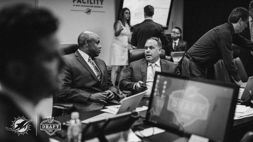 Dolphins GM Chris Grier (middle) and executive vice president Mike Tannenbaum work the war room during the NFL draft. (Photo courtesy of the Miami Dolphins)