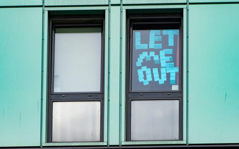 Students have posted protest signs and messages on windows of their rooms in Parker House hall of residence at Abertay University in Dundee. - Alamy/Iain Masterton