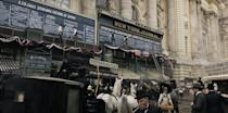"""<p>One of Ammon's favorite sets this season was Newspaper Row, the epicenter of the publishing industry. </p><p>""""Newspaper Row in downtown New York was it was probably the busiest area during that period—and <em>New York Times</em> was there, the<em> Herald</em> was there, the <em>Journal</em> was there, and it was also the end of the train line, so it was this really, really congested space,"""" she explains. </p><p>""""We used one huge building in Budapest. I think it was closed down for renovations, so we were able to use the façade and part of the cobblestone street in front of it to create Newspaper Row. We built the street level of shops, and then above the shops we put all those gigantic billboards, which were like the pre-Twitter, the pre-Instagram. Instant notifications of news were painted and chalked in person with men up on scaffolding and ladders. The masses would stand outside and just watch this and react. It was like the first kind of control and manipulation of the news.""""</p>"""