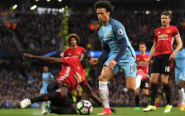 Leroy Sane of Manchester City rides a tackle from Eric Bailly of Manchester United  - Getty Images Europe