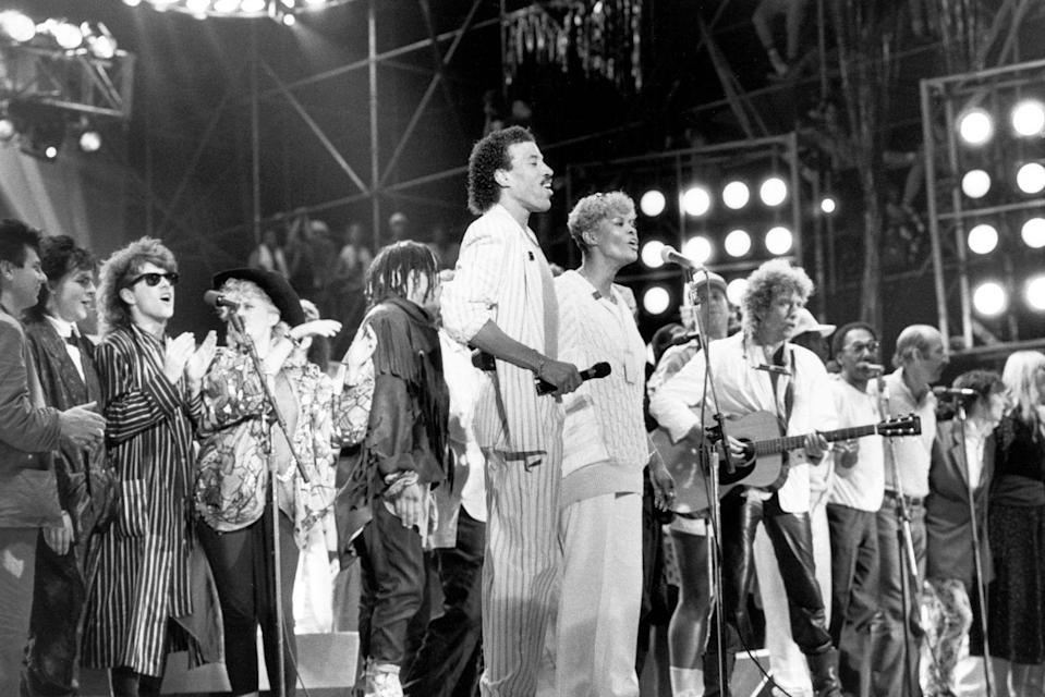 <p>Bob Dylan performing at Live AID with Duran Duran, Thompson Twins, Lionel Richie, Dionne Warwick, Peter, and Paul & Mary in Philadelphia in 1985.</p>