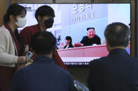 People watch a TV showing an image of North Korean leader Kim Jong Un and his sister Kim Yo Jong during a news program at the Seoul Railway Station in Seoul, South Korea, Saturday, May 2, 2020. Kim made his first public appearance in 20 days as he celebrated the completion of a fertilizer factory near Pyongyang, state media said Saturday, ending an absence that had triggered global rumors that he was seriously ill. (AP Photo/Ahn Young-joon)