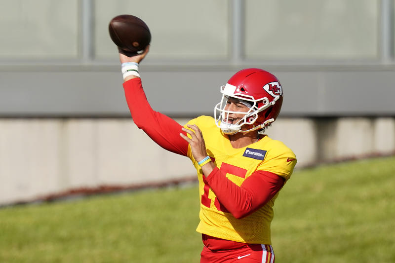 Kansas City Chiefs quarterback Patrick Mahomes throws during an NFL football training camp Friday, Aug. 14, 2020, in Kansas City, Mo. (AP Photo/Charlie Riedel)