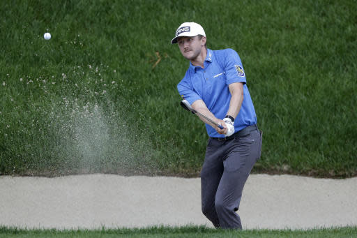 Mackenzie Hughes, of Canada, hits out of a sand trap on the 18th hole during the third round of the Travelers Championship golf tournament at TPC River Highlands, Saturday, June 27, 2020, in Cromwell, Conn. (AP Photo/Frank Franklin II)