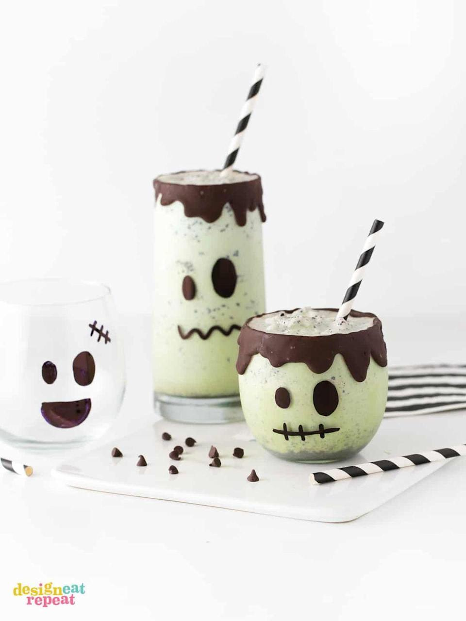 """<p>Mint chip ice cream and a drip effect on the rim make a standard milkshake fit for the spookiest day of the year. </p><p><a class=""""link rapid-noclick-resp"""" href=""""https://www.designeatrepeat.com/easy-frankenstein-halloween-milkshakes/"""" rel=""""nofollow noopener"""" target=""""_blank"""" data-ylk=""""slk:GET THE RECIPE"""">GET THE RECIPE</a></p>"""