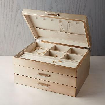 """<h2>West Elm Mid-Century Jewelry Box </h2><br>The most beautiful way to store the most luxurious of jewels, this one's for your fancy friend.<br><br><strong>West Elm</strong> Mid-Century Jewelry Box - Grand (Champagne Lacquer), $, available at <a href=""""https://go.skimresources.com/?id=30283X879131&url=https%3A%2F%2Fwww.westelm.com%2Fproducts%2Fmid-century-box-grand-champagne-lacquer-d4187%2F"""" rel=""""nofollow noopener"""" target=""""_blank"""" data-ylk=""""slk:West Elm"""" class=""""link rapid-noclick-resp"""">West Elm</a>"""