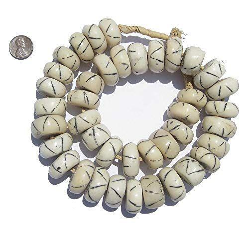 """<p><strong>Carved White Bone Beads</strong></p><p>The Bead Chest</p><p><strong>$31.50</strong></p><p><a href=""""https://www.amazon.com/dp/B01N1VXV8N?tag=syn-yahoo-20&ascsubtag=%5Bartid%7C10069.g.34043814%5Bsrc%7Cyahoo-us"""" rel=""""nofollow noopener"""" target=""""_blank"""" data-ylk=""""slk:Shop Now"""" class=""""link rapid-noclick-resp"""">Shop Now</a></p><p>Designer Mikel Welch adores these fair-trade artisanal beads offered in four varieties. They add a hint of global flair and can dress up your collection of coffee table books. </p>"""