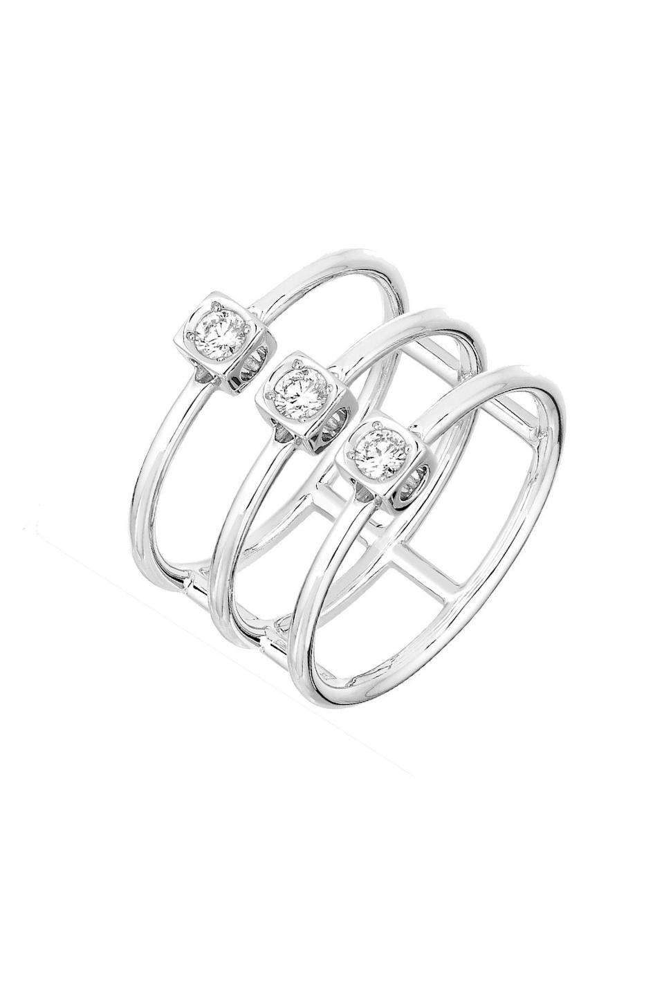 """<p><strong>Dinh Van</strong></p><p>dinhvan.com</p><p><strong>$2420.00</strong></p><p><a href=""""https://www.dinhvan.com/en_us/le-cube-diamant-ring-208612.html"""" rel=""""nofollow noopener"""" target=""""_blank"""" data-ylk=""""slk:Shop Now"""" class=""""link rapid-noclick-resp"""">Shop Now</a></p><p>Minimalist definitely doesn't mean boring with this ring. The white gold setting is open on the sides to showcase the diamonds' best angles (that is, all of them). </p>"""