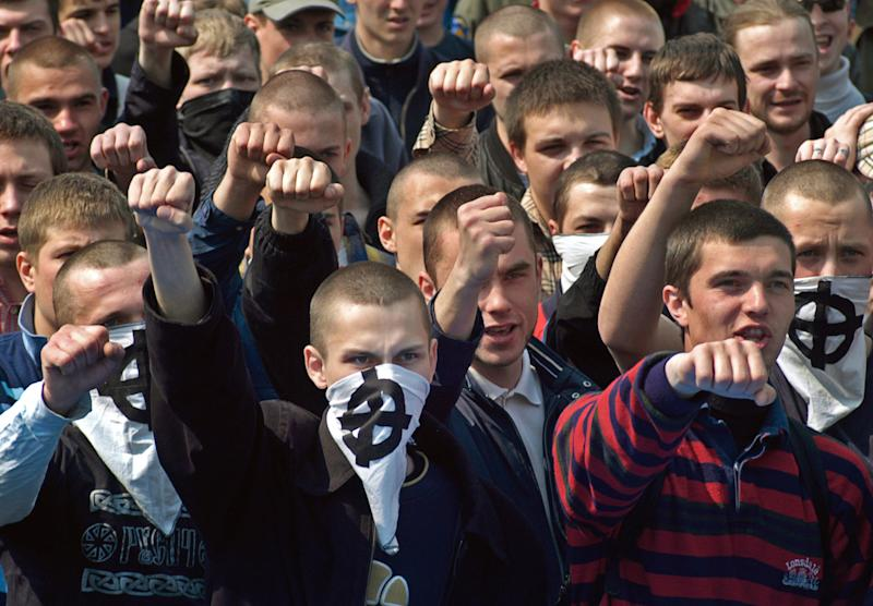 FILE - This file photo dated on May 1, 2006 shows Ukrainian skinheads and nationalists gesture as they take part in a May Day rally in downtown Kiev, Ukraine. With a week to go until the Euro 2012 soccer tournament, Ukraine has been rocked by accusations of rampant racism after a British documentary showed thugs in one the Euro 2012 host cities violently beating dark-skinned soccer fans during a domestic league match. (AP Photo/Sergei Chuzavkov, FILE)