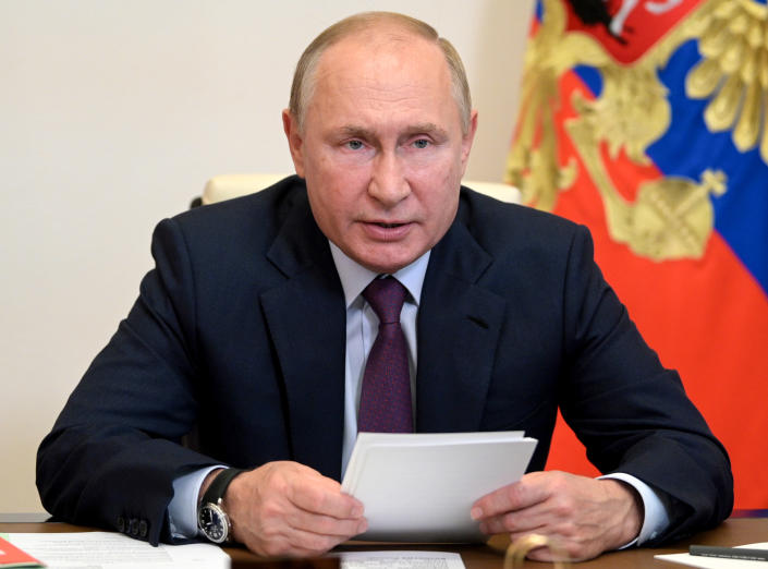 FILE - Russian President Vladimir Putin chairs a Security Council meeting via video conference at the Novo-Ogaryovo residence outside Moscow, Russia, in this Monday, Sept. 27, 2021, file photo. Hundreds of world leaders, powerful politicians, billionaires, celebrities, religious leaders and drug dealers have been stashing away their investments in mansions, exclusive beachfront property, yachts and other assets for the past quarter century, according to a review of nearly 12 million files obtained from 14 different firms located around the world. The report released Sunday, Oct. 3, 2021 by the International Consortium of Investigative Journalists involved 600 journalists from 150 media outlets in 117 countries. Russian President Vladimir Putin is one of 330 current and former politicians identified as beneficiaries of the secret accounts. (Alexei Druzhinin, Sputnik, Kremlin Pool Photo via AP, File)