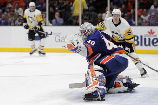 New York Islanders goaltender Robin Lehner, of Sweden, makes a glove save on a shot from the Pittsburgh Penguins during the third period of Game 2 of an NHL hockey first-round playoff series Friday, April 12, 2019, in Uniondale, N.Y. The Islanders won 3-1. (AP Photo/Julio Cortez)
