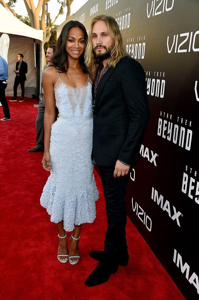 """<p>Zoe Saldana made a triumphant return to the red carpet in this frothy Givenchy number while attending the world premiere of """"Star Trek Beyond"""" in San Diego. Her always stylish husband suited up in all black (except for a plaid shirt). Hair and couple goals. <i>(Photo by Frazer Harrison/Getty Images)</i></p>"""