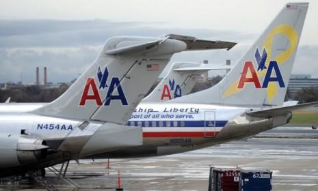 """An American Airlines passenger on a recent flight mishap: """"The seats flipped backwards... People were essentially on the laps of the people behind them with their legs up in the air."""""""