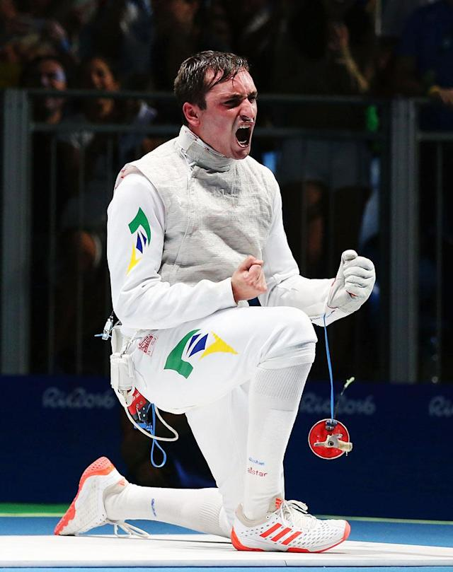 <p>Guilherme Toldo of Brazil celebrates defeating Yuki Ota of Japan during Men's Individual Foil qualification on Day 2 of the Rio 2016 Olympic Games at Carioca Arena 3 on August 7, 2016 in Rio de Janeiro, Brazil. (Photo by Alex Livesey/Getty Images) </p>