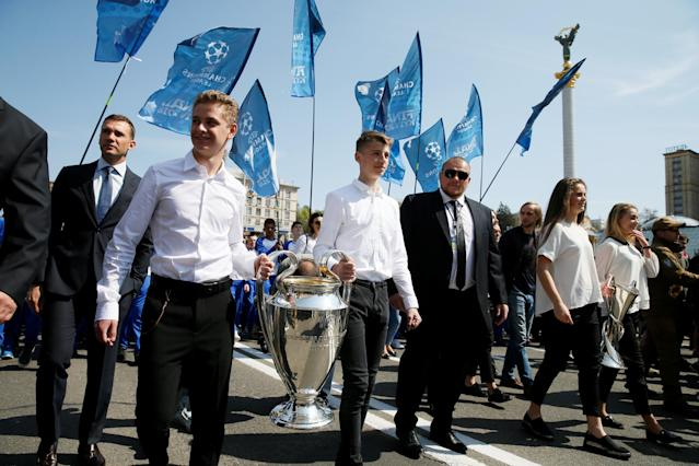 Soccer Football - Kiev receives Champions League trophies - Kiev, Ukraine - April 21, 2018 The Champions League trophies are carried in Independence Square with UEFA Champions League ambassador Andriy Shevchenko REUTERS/Valentyn Ogirenko