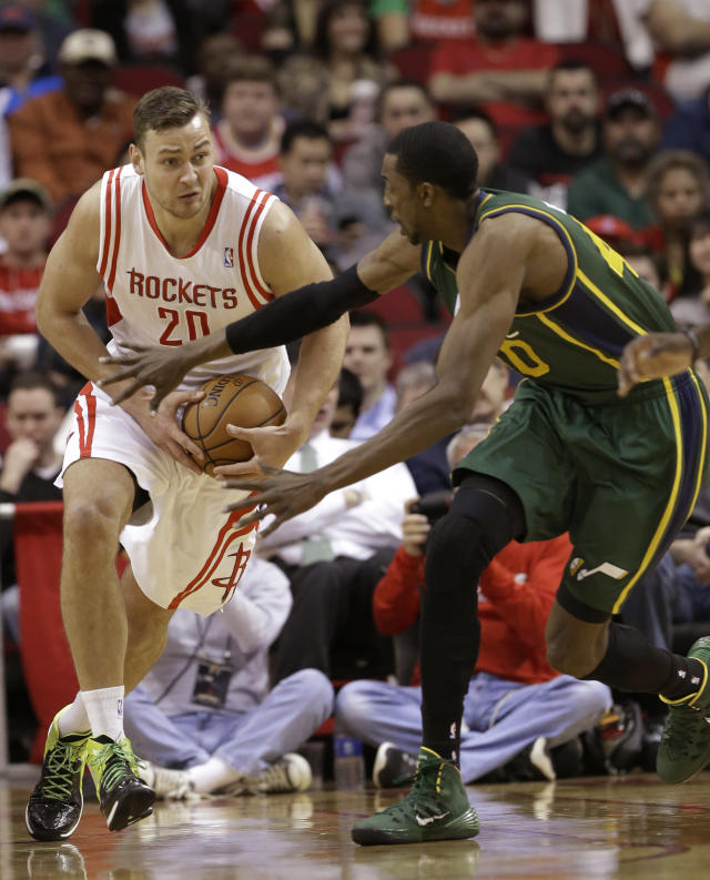 Utah Jazz's Jeremy Evans (40) tries to grab the ball from Houston Rockets's Donatas Motiejunas (20) in the first half of an NBA basketball game Monday, March 17, 2014, in Houston. (AP Photo/Pat Sullivan)