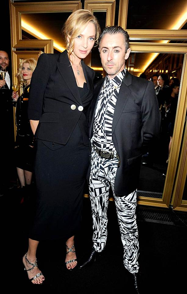 Whoa! Considering this was a fashion show, we were pretty unimpressed with both Uma Thurman's clunky jacket-over-dress combo and and Alan Cumming's way-too-loud patterned shirt and matching pants. (11/8/2011)