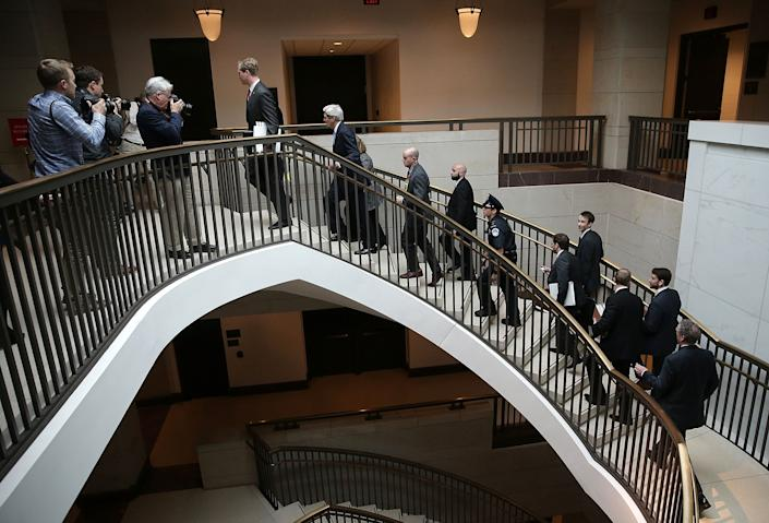U.S. Secretary of State John Kerry is trailed by staff and security while departing a meeting with members of the U.S Senate on the proposed deal with Iran at the U.S. Capitol on April 14, 2015. Kerry met with members of the House and Senate to discuss the ongoing Iran nuclear negotiations.