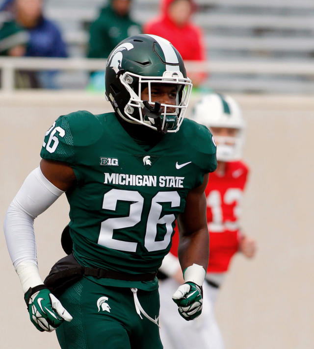 FILE - In this April 7, 2018, file photo, Michigan State linebacker Brandon Randle runs onto the field during an NCAA college football spring scrimmage in East Lansing, Mich. Randle impressed as a defensive end in passing situations last year. He could be a force once he gets more comfortable playing linebacker full-time. (AP Photo/Al Goldis, File)