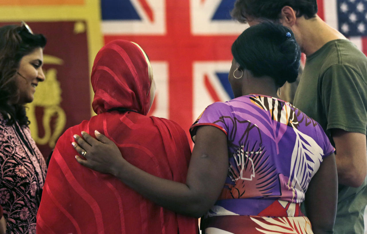 "Rosemary Shav, a chaperone from Nigeria, right, puts her arm on the back of Nafeesa Rahman Qazi, of Northern Pakistan, while attending the ""Common Bond"" summer camp in Newbury, Mass., Wednesday, July 18, 2012.  Teens from across the world who lost loved one due to terrorism gathered for the 10 day camp to share their feelings, insights and a chance to be the worldís next generation of international peacemakers. Qazi, who is a community activist and works in a children's clinic in her homelnad, lost two cousins to the Taliban. (AP Photo/Charles Krupa)"