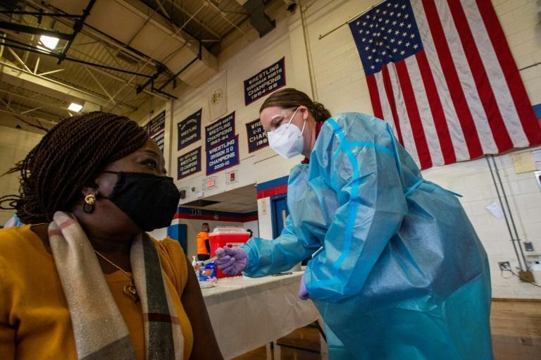 A woman is inoculated with the Moderna Covid-19 vaccine at Central Falls High School in Rhode Island on February 13, 2021