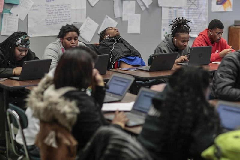 Flint star Taevion Rushing, top center, takes a break from studying in English class.
