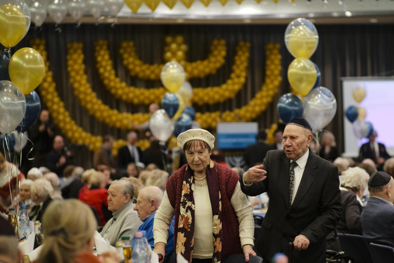 Two holocaust survivors arrive for the International Holocaust Survivors Night of the Jewish Community in Berlin, Germany, Tuesday, Dec. 4, 2018. (AP Photo/Markus Schreiber)