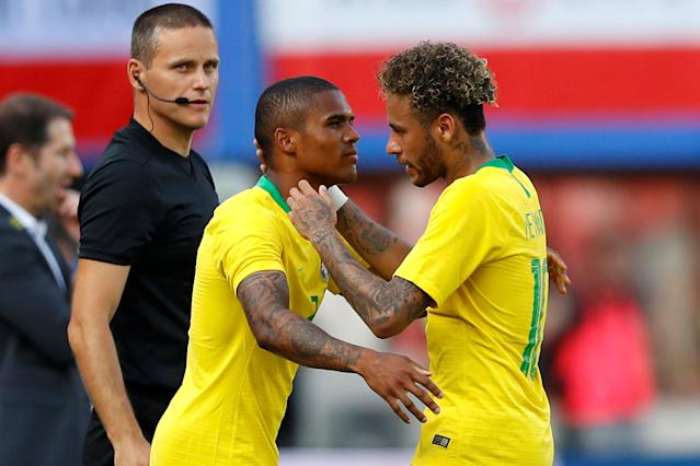 Soccer Football - International Friendly - Austria vs Brazil - Ernst-Happel-Stadion, Vienna, Austria - June 10, 2018 Brazil's Douglas Costa comes on as a substitute to replace Brazil's Neymar REUTERS/Leonhard Foeger