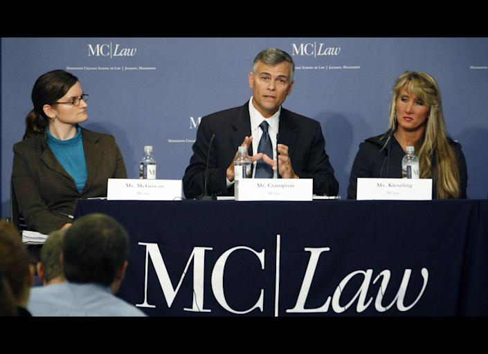 Amelia McGowan, an attorney for the ACLU of Mississippi, left, and Rebecca Kiessling, a family law attorney, right, listen as Stephen Crampton, general counsel for Liberty Counsel discusses the implications of Mississippi's Personhood Initiative in a symposium Tuesday night, Oct. 25, 2011 at the Mississippi College School of Law in Jackson, Miss. The practicing attorneys, law professors and others debated the implications of the state ballot initiative that would declare life begins when a human egg is fertilized. (AP Photo/Rogelio V. Solis)