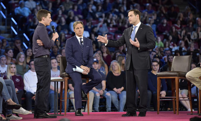 Marjory Stoneman Douglas High School student Cameron Kasky asks Sen. Marco Rubio, right, a question during a CNN town hall meeting at the BB&T Center in Sunrise, Fla., on Feb. 21, 2018.  (Photo: Michael Laughlin/South Florida Sun-Sentinel via AP)