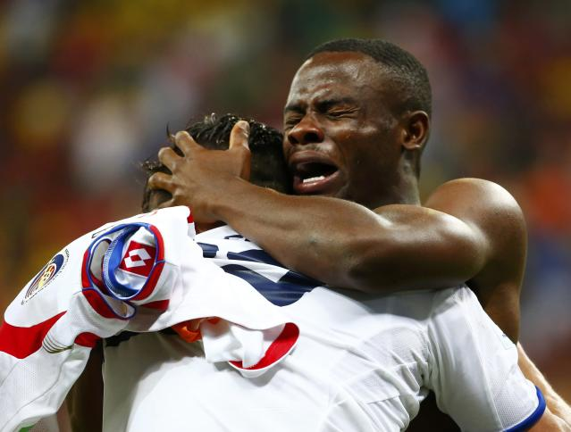 Costa Rica's Waylon Francis (facing camera) and teammate Jose Miguel Cubero embrace after their team won a penalty shootout in their 2014 World Cup round of 16 game against Greece at the Pernambuco arena in Recife June 29, 2014. Costa Rica won the penalty shoot-out 5-3 to advance to the quarter-finals. REUTERS/Tony Gentile (BRAZIL - Tags: SOCCER SPORT WORLD CUP TPX IMAGES OF THE DAY) TOPCUP